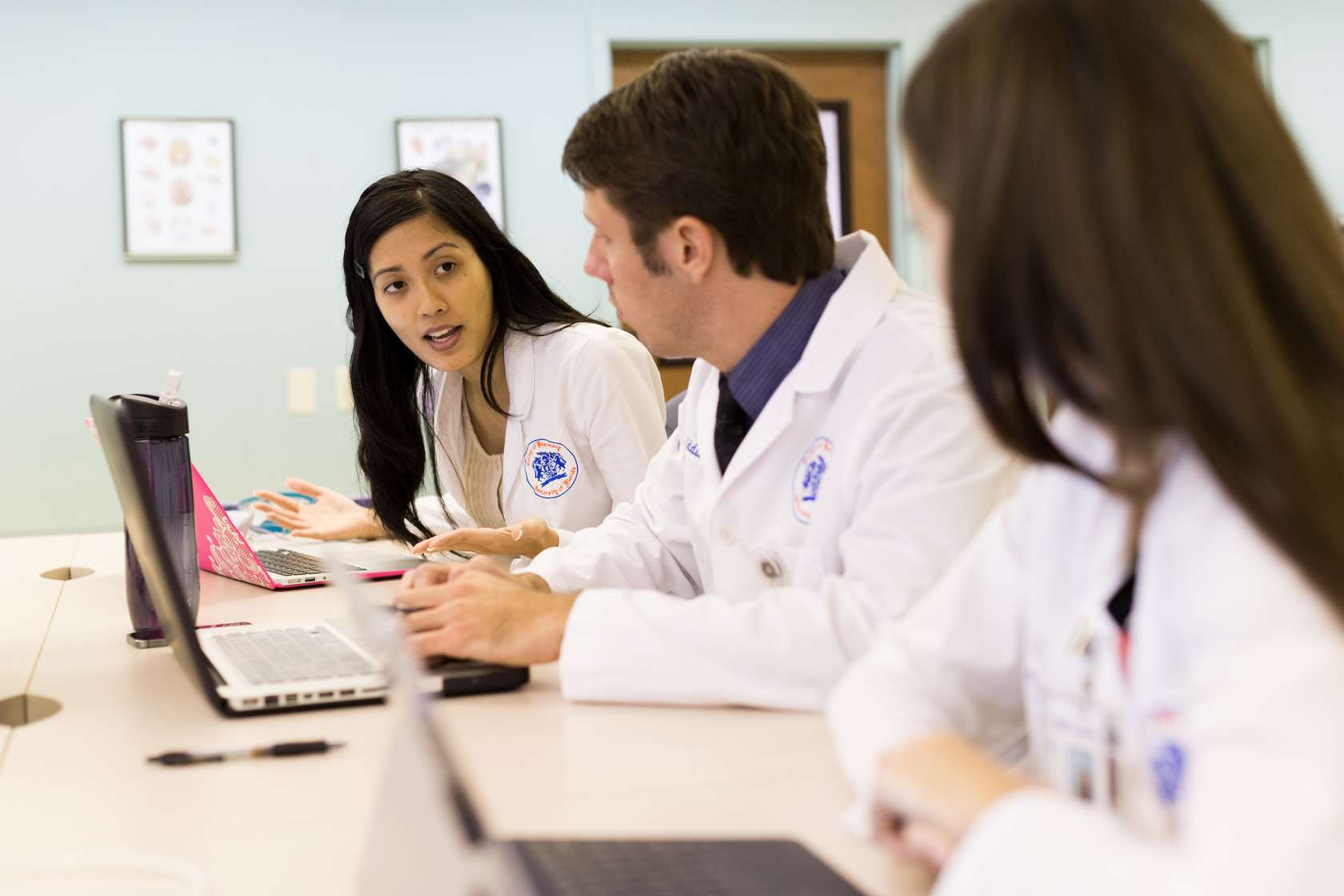 Three medical students in classroom